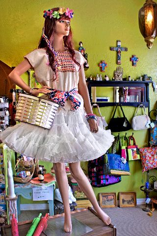 "Identity Vintage's mannequin ""Florence"" has become an Old Town icon.  The shop is one of the featured Hot-Spots for the June Second Saturday Artwalk in Old Town Bay St. Louis."